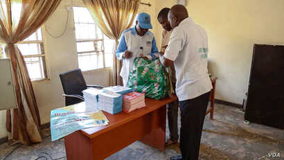 Officials from the Nigerian government's anti-trafficking agency are gathering pamphlets to distribute to the public.