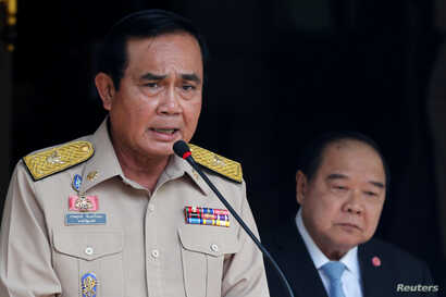 Thailand's Prime Minister Prayuth Chan-ocha speaks during a news conference after his meeting with National Security Council as Deputy Prime Minister and Defence Minister Prawit Wongsuwan looks on at Government House in Bangkok, Aug. 15, 2016.