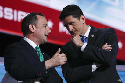 FILE - Speaker Paul Ryan of Wisconsin and Reince Priebus, Chairman of the Republican National Committee, talk at the Republican National Convention in Cleveland, July 19, 2016.