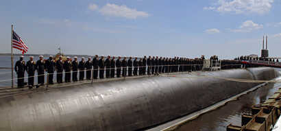The crew of the U.S. Navy's nuclear-powered submarine USS Georgia stand at attention on the stern of the sub at Naval Submarine Base  Kings Bay, Ga., March 28, 2008.