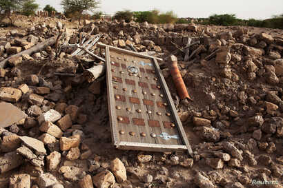 The rubble left from an ancient mausoleum destroyed by Islamist militants, is seen in Timbuktu, July 25, 2013.