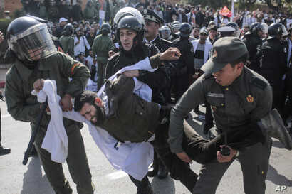 Security forces detain a protesting teacher during a demonstration in Rabat, Morocco, Feb. 20, 2019.