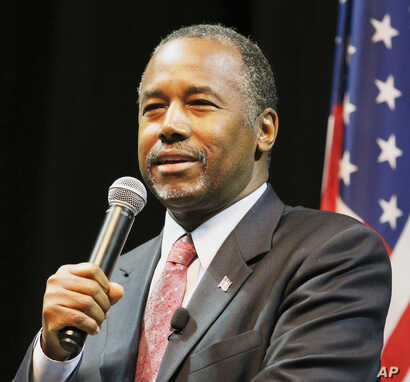 Republican presidential candidate Ben Carson speaks to supporters during a campaign stop, Nov. 19, 2015, in Mobile, Alabama.