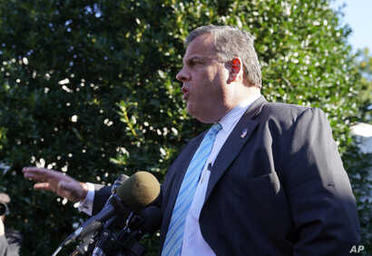 New Jersey Gov. Chris Christie speaks to members of the media outside the West Wing of the White House in Washington after attending President Donald Trump speaking on the opioid crisis, Oct. 26, 2017.