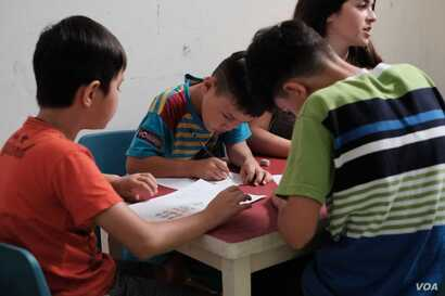 Children participate in the Art for Refuge program at Roshan Learning Center in Jakarta, Indonesia. Indonesia does not deport asylum seekers and refugees back to potential danger.