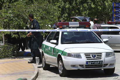 Police control the scene at the shine of late Iranian revolutionary founder Ayatollah Khomeini, just outside Tehran, Iran, June 7, 2017.