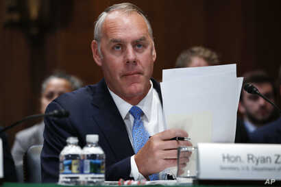 Interior Secretary Ryan Zinke arrives for a Senate Appropriations subcommittee hearing on the fiscal 2019 budget, May 10, 2018, on Capitol Hill in Washington.