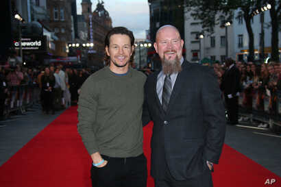 Oil rig manager Mike Williams, right, who is portrayed by actor Mark Wahlberg, left, arrive at the premiere of the film 'Deepwater Horizon' in London. The movie opens in theaters Friday.