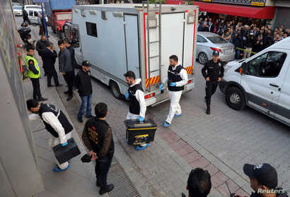 Turkish police forensic experts arrive at a car park where a vehicle belonging to Saudi Arabia's consulate was found, in Istanbul, Turkey, Oct. 22, 2018.