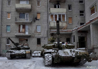 FILE -  Tanks are seen in the government-held industrial town of Avdiyivka, Ukraine, Feb. 2, 2017.