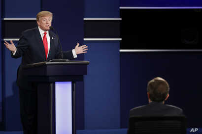Republican presidential nominee Donald Trump answers a question during the third presidential debate at UNLV in Las Vegas, Wednesday, Oct. 19, 2016. (AP Photo/John Locher)