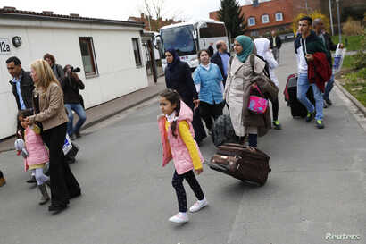Syrian refugees arrive at the camp for refugees and migrants in Friedland, Germany, April 4, 2016.