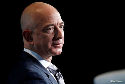 FILE - Jeff Bezos, CEO of Amazon, speaks at a conference in Washington, March 7, 2017.