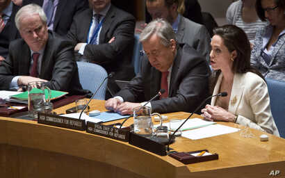 U.N. High Commissioner for Refugees Antonio Guterres listens as U.N. Special Envoy for Refugees Angelina Jolie Pitt addresses the Security Council on Syria's refugee crisis, April 24, 2015.