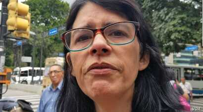 Luisa Mago Machado: 'I've spent all Christmas without medicine and that's why I'm crying.' (N. Kolster/VOA)