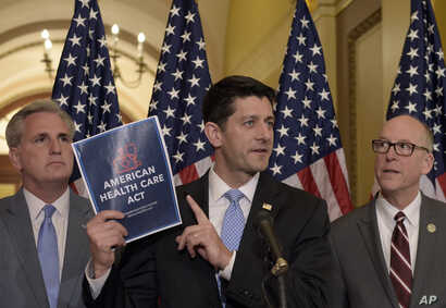 House Speaker Paul Ryan, R-Wis., center, stands with Greg Walden, R-Ore., right, and House Majority Whip Kevin McCarthy, R-Calif., during a news conference on the American Health Care Act on Capitol Hill.