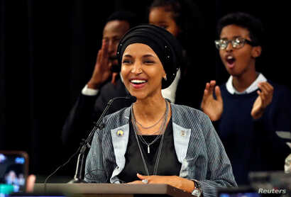 Democratic congressional candidate Ilhan Omar reacts after appearing at her midterm election night party in Minneapolis, Minnesota, Nov. 6, 2018.