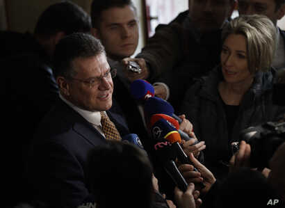 FILE - Presidential candidate and European Commission Vice-President Maros Sefcovic speaks to media after casting his vote during the first round of presidential elections, in Bratislava, Slovakia, March 16, 2019.