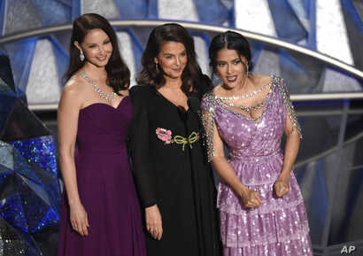 Ashley Judd, from left, Annabella Sciorra and Salma Hayek speak at the Oscars, March 4, 2018.