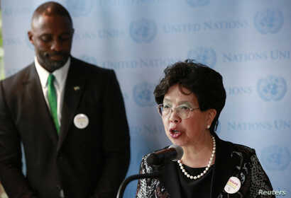 Director-General of the World Health Organization (WHO) Margaret Chan (R) and British actor Idris Elba attend a news conference on Ebola at the U.N. headquarters in New York, September 25, 2014. REUTERS/Shannon Stapleton (UNITED STATES - Tags: POLITI