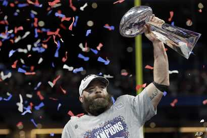 New England Patriots' Julian Edelman holds the trophy after the NFL Super Bowl 53 football game against the Los Angeles Rams, Sunday, Feb. 3, 2019, in Atlanta.