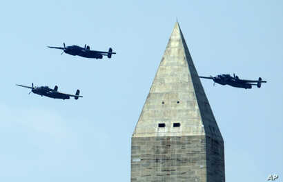The North American B-25 Mitchell bombers, fly the Doolittle Raid formation during a flyover over near the Washington Monument over  Washington, May 8, 2015.