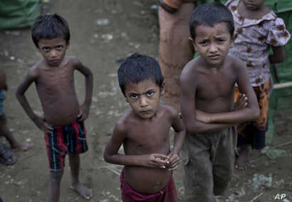 FILE - Rohingya children gather at the Dar Paing camp for Muslim refugees, north of Sittwe, western Rakhine state, Myanmar.