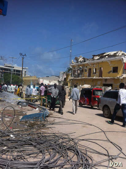 A photo, provided to VOA's Somali Service, shows the destruction of Naso-Hablod hotel and surrounding areas, in Mogadishu, Somalia, June 26, 2016. The photo was taken by a bystander who wished to remain anonymous.