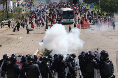 Riot police battle with protesting teachers who were blocking a federal highway in the state of Oaxaca, near the town of Nochixtlan, Mexico, June 19, 2016.