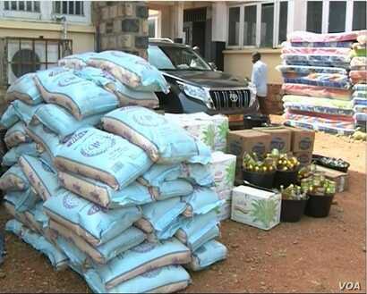 Piles of food aid, left, and mattresses, right, are distributed to internally displaced people in the English-speaking town of Bamenda. April 3, 2019.