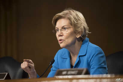 Sen. Elizabeth Warren, D-Mass., questions Federal Reserve Chairman Jerome Powell during hearing of the Senate Banking, Housing and Urban Affairs Committee, Feb. 26, 2019 in Washington.