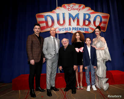 "Cast members Colin Farrell, Michael Keaton, Danny DeVito, Nico Parker, Finley Hobbins and Eva Green pose at the premiere for the movie ""Dumbo"" in Los Angeles, California, March 11, 2019."