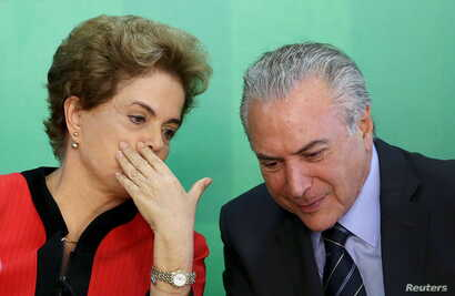 FILE - Brazil's President Dilma Rousseff (L) talks to Vice President Michel Temer at the Planalto Palace in Brasilia, Brazil, March 2, 2016.