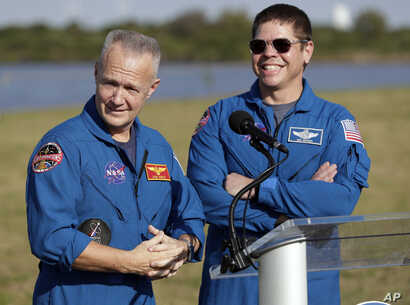 NASA astronauts Doug Hurley, left, and Bob Behnken answer questions during a news conference, March 1, 2019, before the Falcon 9 SpaceX Crew Demo-1 rocket launch at the Kennedy Space Center in Cape Canaveral, Fla. The astronauts are assigned to fly i...