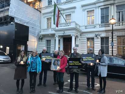 Rights activists hold a vigil for Nazanin Zaghary-Ratcliffe, a British-Iranian woman detained in Iran, outside the Iranian embassy in London, Jan. 16, 2017. (Photo courtesy of Amnesty International)