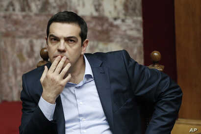 Greece's Prime Minister Alexis Tsipras gestures during a parliamentary session in Athens, March 30, 2015, after Tsipras called the special session of parliament to brief lawmakers on the course of recent troubled negotiations with bailout lenders to ...