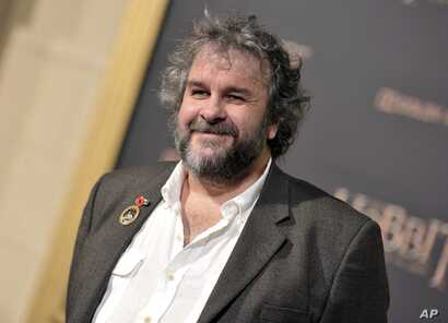 """FILE - In this Dec. 9, 2014 file photo, writer/director/producer Peter Jackson arrives at the Los Angeles premiere of """"The Hobbit: The Battle Of The Five Armies"""" in Los Angeles."""