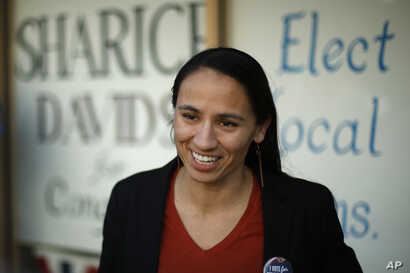 Democratic congressional candidate Sharice Davids talks to supporters at her campaign office, Oct. 22, 2018, in Overland Park, Kan. Davids is challenging Republican incumbent Kevin Yoder in Kansas' 3rd District.