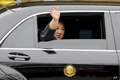 North Korean leader Kim Jong Un waves from a car after arriving by train in Dong Dang in Vietnamese border town, Feb. 26, 2019, ahead of his second summit with U.S. President Donald Trump.