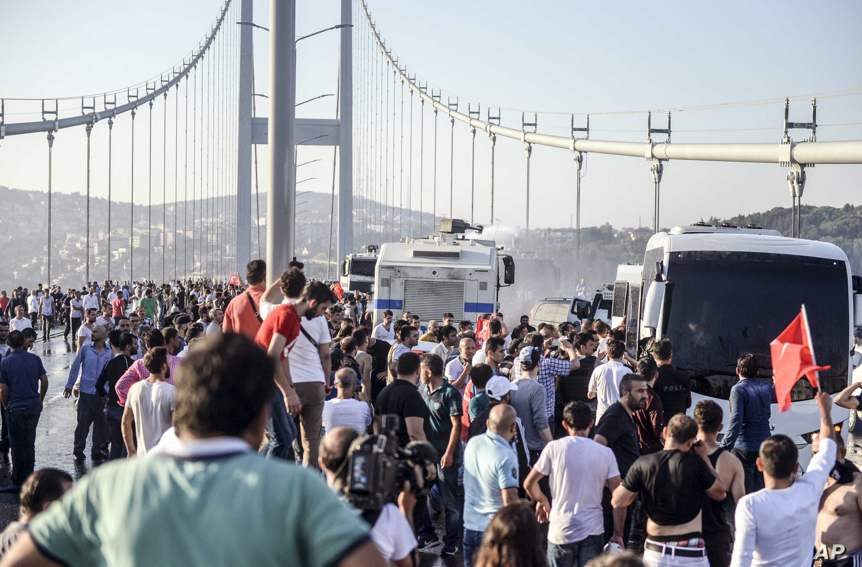 People against the attempted coup gather on Istanbul's Bosporus Bridge, July 16, 2016. Coup plotters had briefly closed the bridge and another span over the Bosphorus Strait in their attempted takeover.
