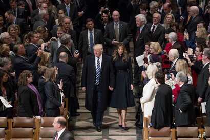 President Donald Trump, accompanied by first lady Melania Trump, arrive for a National Prayer Service at the National Cathedral, in Washington, Jan. 21, 2017.