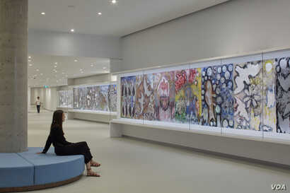 Jean-Paul Riopelle's Tribute to Rosa Luxembourg. At 40 meters, it is the largest work in the museum and the largest Riopelle ever created. It is displayed in an underground passage leading to the new pavilion.