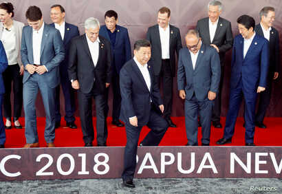 Leaders pose for a family photo ahead of the retreat session during the APEC Summit in Port Moresby, Papua New Guinea, Nov. 18, 2018.