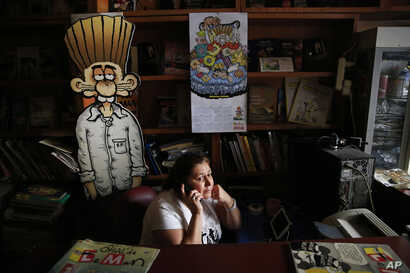 A worker at the office building housing the Turkish satirical cartoon magazine Leman, talks on the phone in Istanbul, July 25, 2016.
