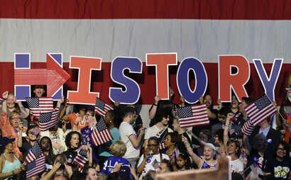 Supporters of Democratic presidential candidate Hillary Clinton hold up letters to spell out the significance of the day's voting results during a presidential primary election night rally in New York, June 7, 2016.