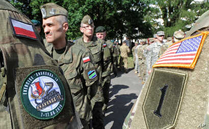 Polish Army and U.S. Army soldiers attend the opening ceremony of the Anaconda-16 military exercise, in Warsaw, Poland, June 6, 2016.