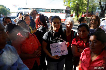 Supporters of Teodora Vasquez wait outside the jail after Vasquez's 30-year sentence was commuted by El Salvador's Supreme Court, in Ilopango, El Salvador, Feb. 15, 2018.