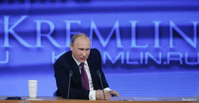 "FILE - Russian President Vladimir Putin speaks during his annual end-of-year news conference in Moscow, Dec. 18, 2014. Putin said on Thursday former oil tycoon Mikhail Khodorkovsky, one of his biggest critics, had the right to engage in politics ""as ..."
