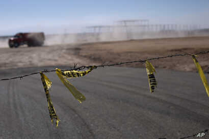 Barbed wire surrounds the site of a cancelled Ford auto manufacturing plant, one day after the U.S. auto company announced the project was called off, in Villa de Reyes, Mexico, Wednesday, Jan. 4, 2017.