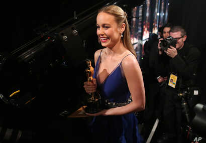 "Brie Larson appears backstage with the award for best actress in a leading role for ""Room"" at the Oscars, Feb. 28, 2016, at the Dolby Theatre in Los Angeles."